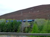 Train making its way through The Slochd. In August the hills would be purple with Heather.
